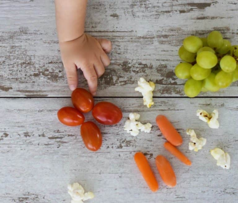Cherry tomatoes, popcorn, grapes and carrots are a choking hazard for baby-led weaning tots.