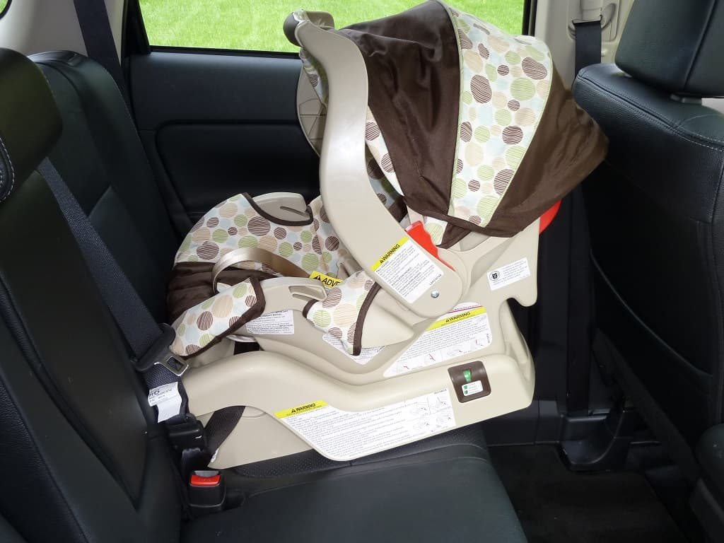 The car seat should installed in the middle seat for maximum safety