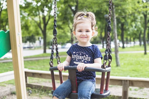 Portrait of cute girl sitting in the swing | Free Photo